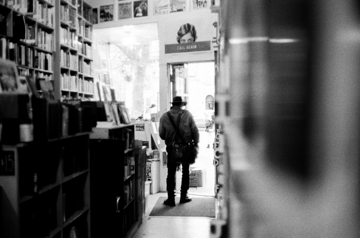 Marc Danis, a client of Librairie Encore, located on Sherbrooke Street in Montreal, Que., leaves the bookstore, on Saturday, Nov. 21, 2015. Danis come here often, mainly to buy used DVD and vinyls. « I always come here with the hope to find hidden gems, so I can spend the afternoon searching,» said Danis about Librairie Encore.(Marie-Pierre Savard / JOUR523)