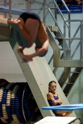 Nine year old athlete, Charlie Rose Arseneault, observes her colleague, Édouard Thérien, 10, diving during a training with Club Aquatique Rosemont-Petite-Patrie, on Tuesday, Nov. 3, 2015, at the Rosemont Pool, in Montreal, Que. Arseneault joined the Club in 2013, trains five hours per week and had participated in many competitions in Quebec throughout the year.(Marie-Pierre Savard /JOUR523)