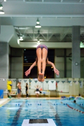 Nine year old athlete, Charlie Rose Arseneault, jumps into the pool after a two-hour training with Club Aquatique Rosemont-Petite-Patrie, on Tuesday, Nov. 3, 2015, at the Rosemont Pool, in Montreal, Que. Arseneault joined the Club in 2013 and trains five hours per week and participated in many competitions around Quebec over the years.(Marie-Pierre Savard /JOUR523)