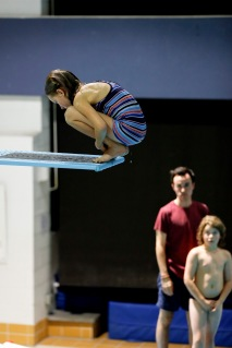 Nine year old athlete, Charlie Rose Arseneault, jumps into the pool after a two-hour training with Club Aquatique Rosemont-Petite-Patrie, on Tuesday, Nov. 3, 2015, at the Rosemont Pool, in Montreal, Que. Arseneault jumped in front of her coach, Dominic Bélanger and athlete Adam Samson .(Marie-Pierre Savard /JOUR523)