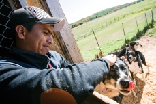 Guatemalteque seasonal agricultural worker, Luis Eduardo Alvarado, plays with Coco, one of the dozens of dogs owned by the Ferme Les Canardises, in Saint-Féréol-Les-Neiges, Que., on Sunday, Nov. 1, 2015. Eduardo works for them since three years and goes back to Guatemala each winter. (Marie-Pierre Savard /JOUR523)